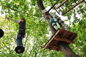 Children enjoying in a climbing adventure activity park — Stock Photo