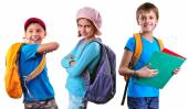 Schoolchildren of grade school with backpack and books — Stock Photo