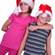 Happy children with Santa Claus red hats — Stock Photo #54223209