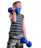 Isolated portrait of child exercising with dumbbells  — Stok fotoğraf