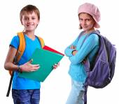 Pupils of grade school with backpack and books — Stock Photo
