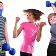 Isolated portrait of children exercising with dumbbells  — Stock Photo #54659331
