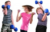 Isolated portrait of children exercising with dumbbells  — Stock Photo