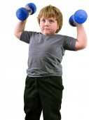 Isolated portrait of elementary age boy with dumbbells exercising — Stock fotografie