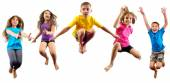 Happy children exercising and jumping — Foto de Stock