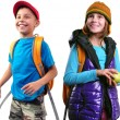 Happy smiling schoolgirl and boy with backpacks isolated — Stock Photo #55142485