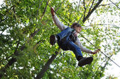 Child in a climbing adventure activity park — Stock Photo