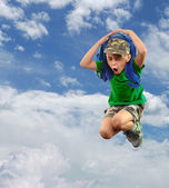 Worried or scared schoolchild with backpack against sky — Stock Photo