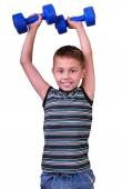 Isolated portrait of elementary age boy with dumbbells exercising — Fotografia Stock