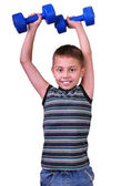 Isolated portrait of elementary age boy with dumbbells exercising — Stock Photo
