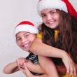 Happy children with Santa Claus red hats — Stock Photo #55293721