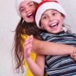 Happy children with Santa Claus red hats — Stock Photo #55293953