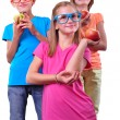 Group of children with apples wearing eyeglasses isolated over white — Stock Photo #55462099