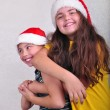 Happy children with Santa Claus red hats — Stock Photo #55625809