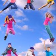 Happy children exercising and jumping in the blue sky — Stock Photo #55912019