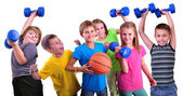 Team of sportive kids friends with dumbbells and ball — Стоковое фото