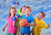 Group of sporty children friends with dumbbells and ball — 图库照片