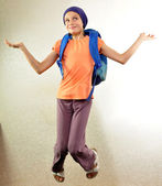 Schoolboy with backpack jumping and running — Stock Photo