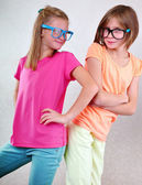 Playful girlfriends with eyeglasses — Stock Photo