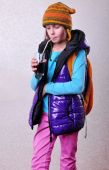 Girl with backpack and hat drinking cola  — Stock Photo