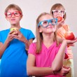 Group of funny kids with apples posing — Stock Photo #67147501