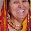 Happy laughing senior woman in traditional Indian clothing and jeweleries — Stock Photo #68786429