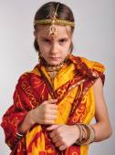 Gloomy little girl in traditional Indian clothing and jeweleries — Stock Photo