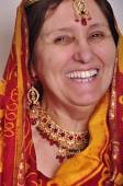 Happy laughing senior woman in traditional Indian clothing and jeweleries — Stock Photo