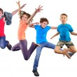 Happy dancing jumping children isolated over white background — Stock Photo #72975017