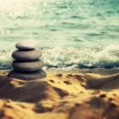 Pebble on sand — Stock Photo