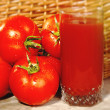 Fresh tomatoes and of juice — Stock Photo #56623799