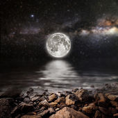 Month on a background star sky reflected in the sea. — Stock Photo