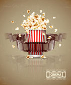 Jumping popcorn and movie film tape — Stock Vector