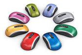 Color computer mouse arranged in circle — Stock Photo