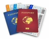 Biometric passports and air tickets — Stock Photo
