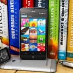 Smartphones and smartwatch on bookshelf — Stock Photo #57066335