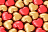 Red and golden hearts — Stock Photo