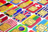 International SIM cards with flags — Stock Photo