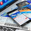 Buying air tickets online via smartphone — Stock Photo #75041153