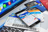 Buying air tickets online via smartphone — Stock Photo
