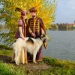 Couple in medieval costumes with borzoi dog — Stock Photo #72151165