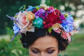 Young attractive woman with coronet of flowers — Stock Photo