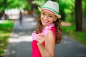 Young woman in pink dress at green summer park — Стоковое фото