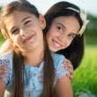 Portrait of two hispanic teen girls — Stock Photo #56504707