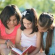 Three happy teen girls reading — Stock Photo #56741435