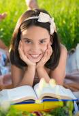 Happy child studying on nature — Stock Photo