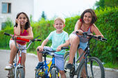Portrait of three little cyclists — Stock Photo