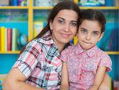Cute little preschool girl with her mother — Foto de Stock