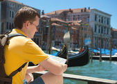 Young man with map in Venice — Stock Photo