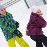 Children throwing snowballs — Stock Photo #63817075
